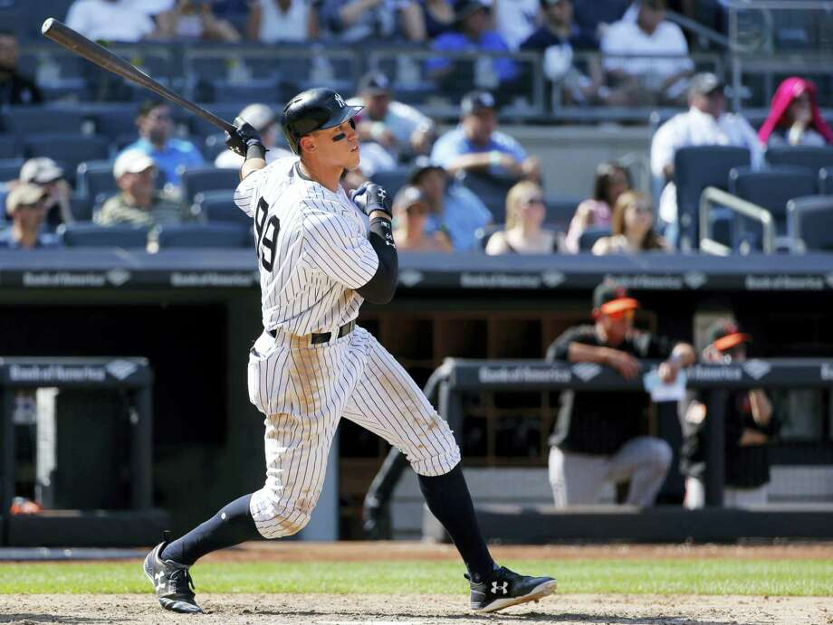 The Yankees' Aaron Judge watches his seventh-inning, two-run, home run against the Orioles on Sunday. Photo: Kathy Willens — The Associated Press  / Copyright 2017 The Associated Press. All rights reserved.