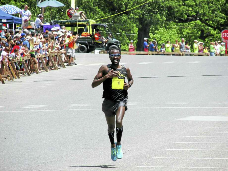 Kenya's Eliud Ngetich was all alone at the finish for his fourth Litchfield Hills Road Race victory on Sunday. Photo: Photo By Peter Wallace