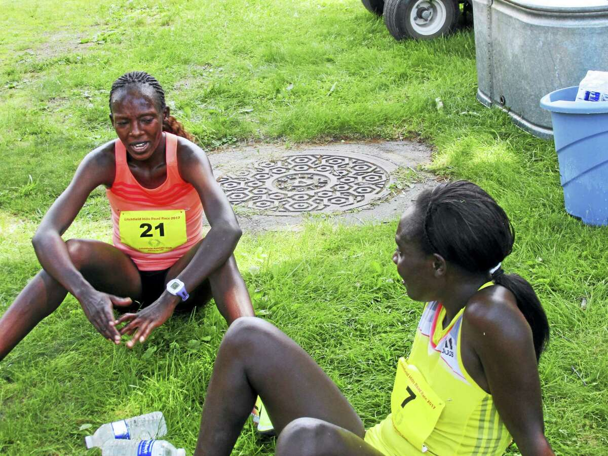 Gladys Kipsoi, right, and Emma Jabet finished first and second among the women on a hot day Sunday at the Litchfield Hills Road Race.