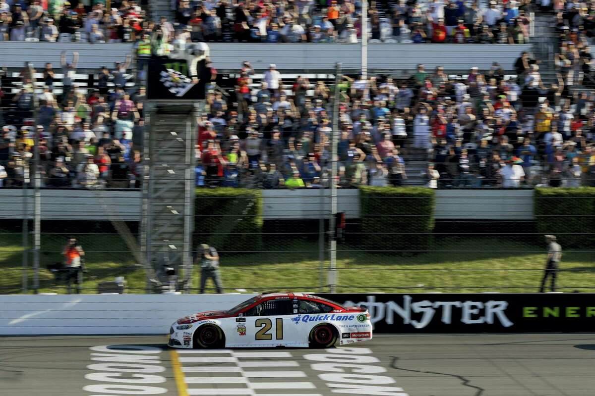 Ryan Blaney takes the checkered flag to win the Pocono 400 Sunday in Long Pond, Pa.