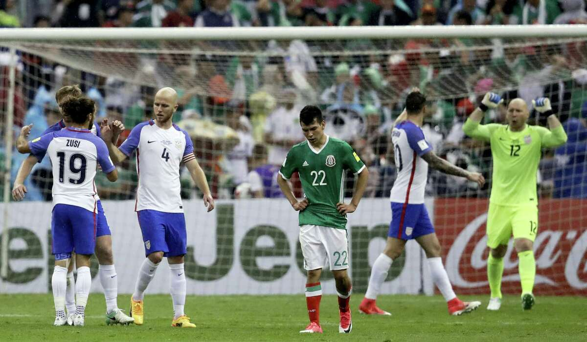 United States' Michael Bradley (4), Graham Zusi (19) and goalkeeper Brad Guzan, right, celebrate at the end of their draw against Mexico at Azteca Stadium in Mexico City on Sunday.