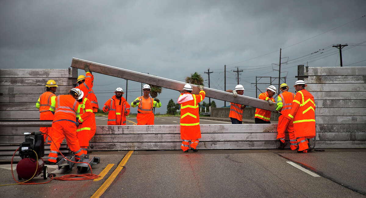 TxDOT crews install the final portion of a surge wall on TX-361 leading to the Port Aransas ferry in Aransas Pass, Texas, on Friday, Aug. 25, 2017.