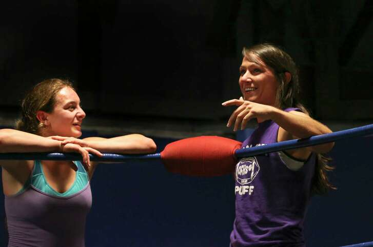 Kylie Rae, right, and McKensie Piar have a chat outside of the ring during training at Reality of Wrestling Thursday, Aug. 17, 2017, in Texas City. Rae and Piar were the two women wrestlers training in the advancced ring on Thursday. ( Yi-Chin Lee / Houston Chronicle )