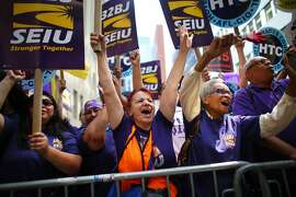 FILE � Service Employees International Union members rally in support of raising the minimum wage, in New York, July 22, 2015. The SEIU will fund an extensive campaign to elect politicians with labor-friendly stands on the minimum wage, unions and health care in the build-up to the 2018 elections, it announced on Aug. 24, 2017. (Chang W. Lee/The New York Times)