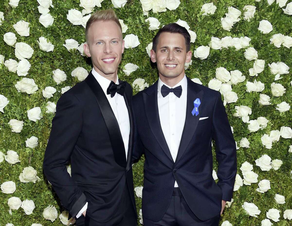 Justin Paul, left, and Benj Pasek arrive at the 71st annual Tony Awards at Radio City Music Hall on Sunday in New York.