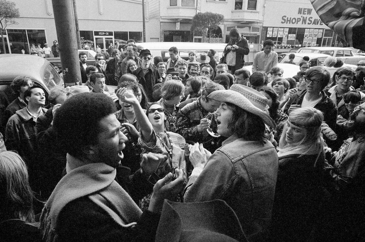 ADVANCE FOR USE TUESDAY, JUNE 13, 2017 AND THEREAFTER-FILE - In this April 13, 1967 file photo, people gather in the Haight-Ashbury district in San Francisco. In 2017's Haight-Ashbury neighborhood, which had been ground zero for the counterculture, two-bedroom apartments now rent for $5,000 a month. San Francisco remains a magnet for young people, but even those earning six-figure Silicon Valley salaries complain about the cost of living. (AP Photo/Robert W. Klein, File)