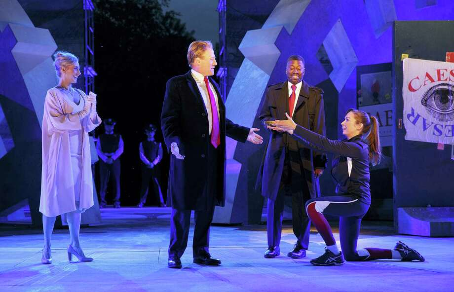 In this May 21, 2017 photo provided by The Public Theater, Tina Benko, left, portrays Melania Trump in the role of Caesar's wife, Calpurnia, and Gregg Henry, center left, portrays President Donald Trump in the role of Julius Caesar during a dress rehearsal of The Public Theater's Free Shakespeare in the Park production of Julius Caesar, in New York. Rounding out the cast on stage is Teagle F. Bougere as Casca, and Elizabeth Marvel, right, as Marc Anthony. (Joan Marcus/The Public Theater via AP) Photo: AP / ©2017 Joan Marcus