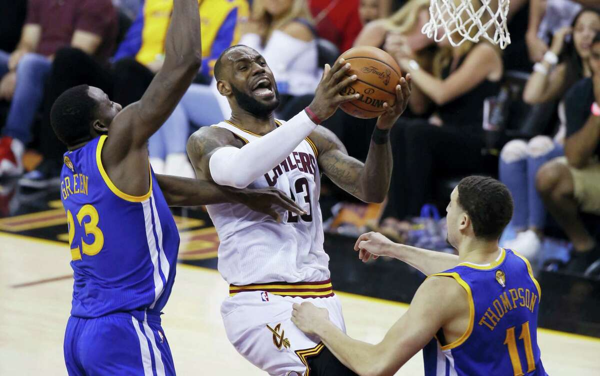 Cavaliers forward LeBron James drives to the basket during Game 4 of the NBA Finals in Cleveland on Friday.