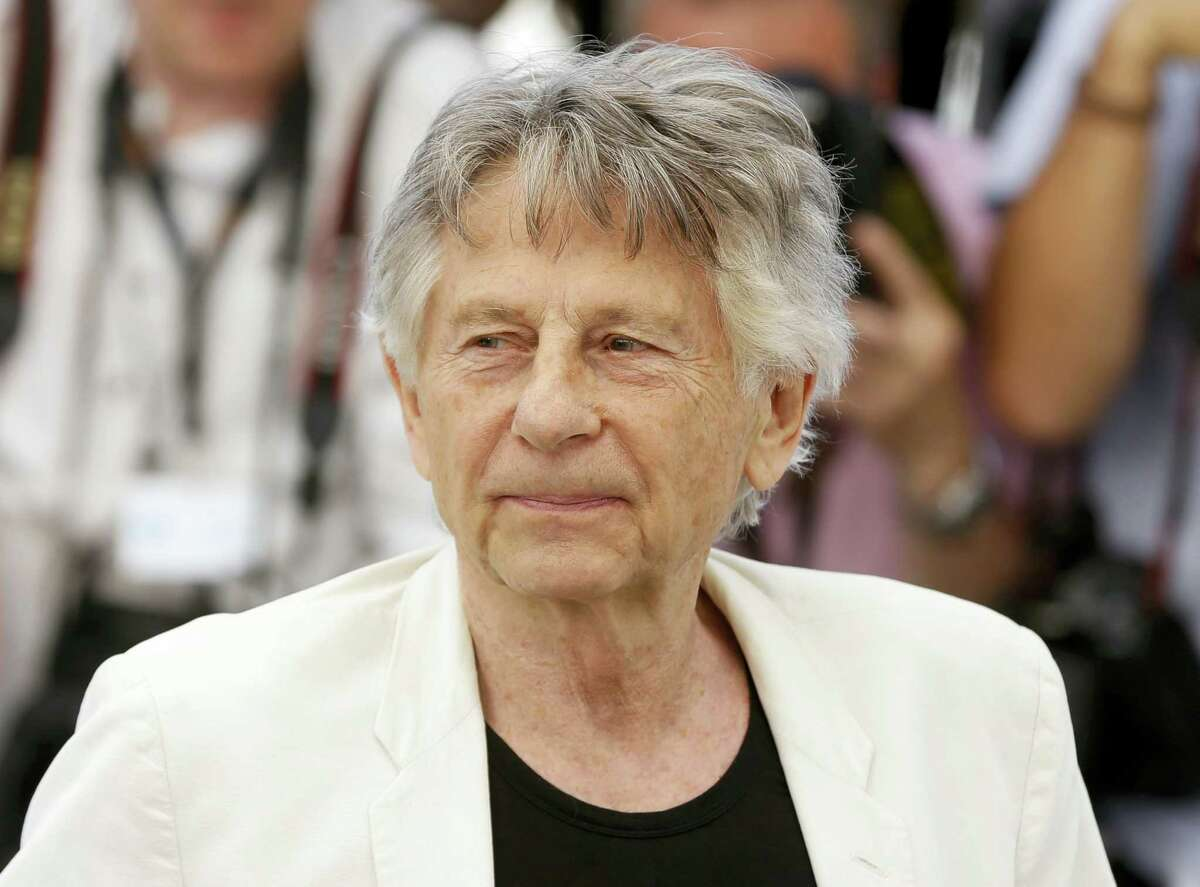 """In this May 27, 2017, photo, director Roman Polanski appears at the photo call for the film, """"Based On A True Story,"""" at the 70th international film festival, Cannes, southern France. A lawyer for Polanski says his sex crime victim will appeal to a judge to end the case against him. Attorney Harland Braun said Samantha Geimer will appear Friday, June 9, 2017 in Los Angeles Superior Court to help make the case that Polanski has served his time for the 40-year-old crime."""
