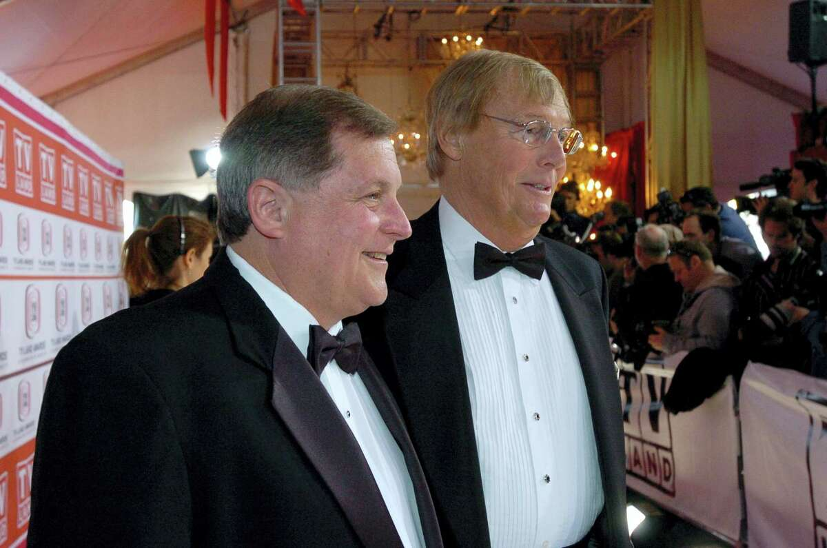 In this March 19, 2006, file photo, Burt Ward, left, and Adam West pose for photos while walking the red carpet prior to the TV Land Awards, in Santa Monica, Calif. On Saturday, June 10, 2017, West'Äôs family said the actor, who portrayed Batman in a 1960s TV series, has died at age 88.