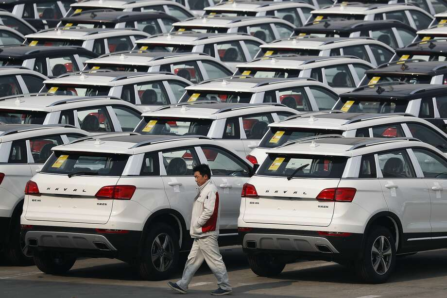 A worker walks past Haval SUV models parked outside the Great Wall Motors plant in Baoding. Great Wall is considering a bid to acquire the Jeep unit. Photo: Andy Wong, Associated Press