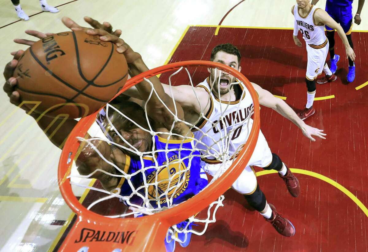 Warriors forward Andre Iguodala dunks on Cavaliers forward Kevin Love during the NBA Finals.