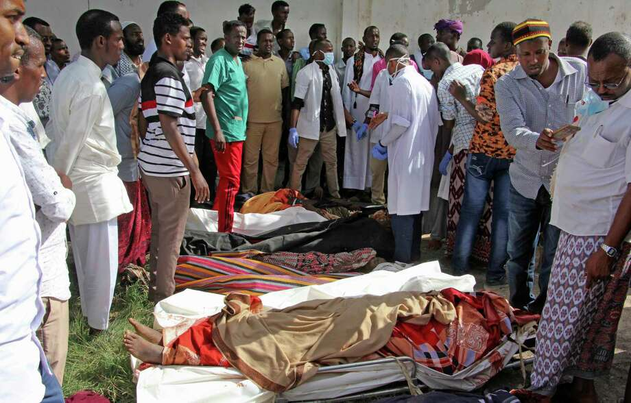 Somalis observe bodies which were brought to and displayed in the capital Mogadishu, Somalia on Friday, after attacks there led to the deaths of civilians. The U.S. military is investigating. Photo: Farah Abdi Warsameh, STR / Copyright 2017 The Associated Press. All rights reserved.