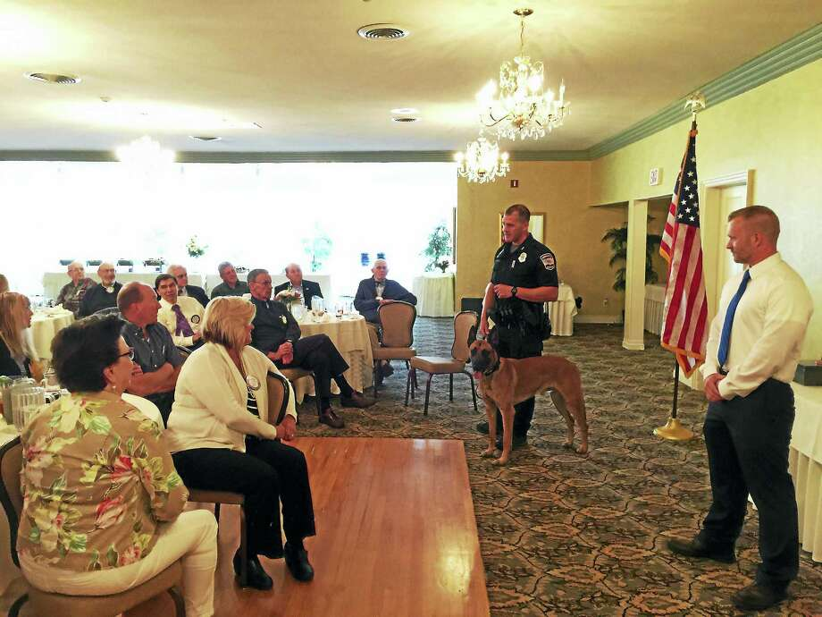Officer Brandon Kelly and Officer John Loucke — along with his canine partner, Pharaoh — met to discuss the Police Explorers program with the Torrington-Winsted Area Rotary Club this week. Photo: Ben Lambert — The Register Citizen