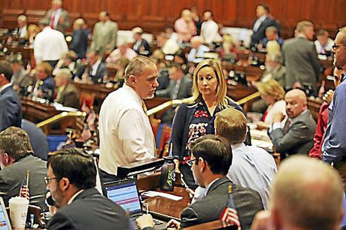 Speaker Joe Aresimowicz and Rep. Liz Linehan, D-Cheshire, chat with Majority Leader Matt Ritter in the House.