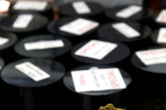 Cannisters of the Gorilla Glue and James Franco varieties of medical marijuana are displayed on a counter at the Mission Organic dispensary in San Francisco, Calif. on Wednesday, Aug. 23, 2017.
