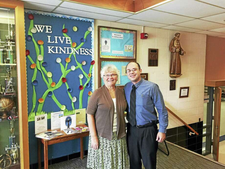 Retiring principal Patricia Devanney and new principal Lou Howe paused for a photograph on Friday in the halls of St. Anthony School in Winsted. Photo: Ben Lambert — The Register Citizen