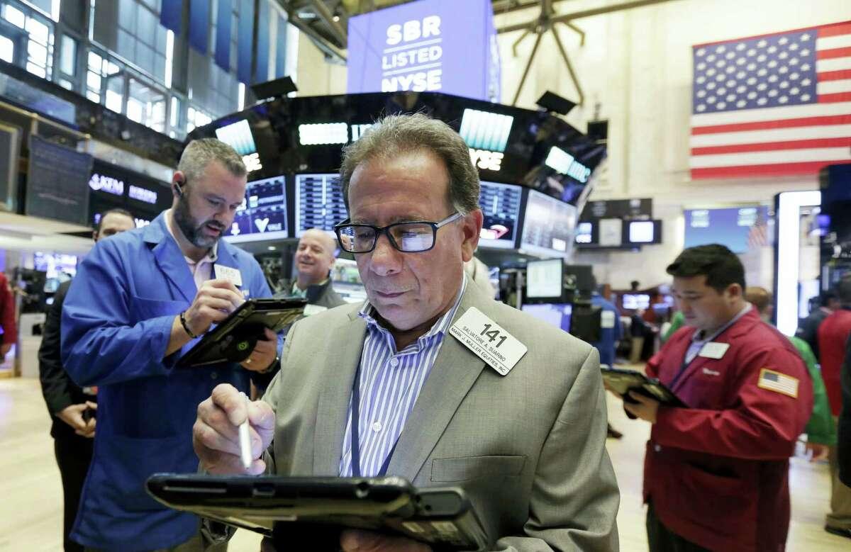 Stock trader Salvatore Suarino works at the New York Stock Exchange Friday.