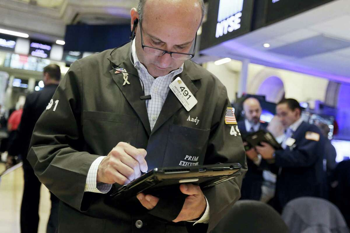 Trader Andrew Silverman works on the floor of the New York Stock Exchange Friday.