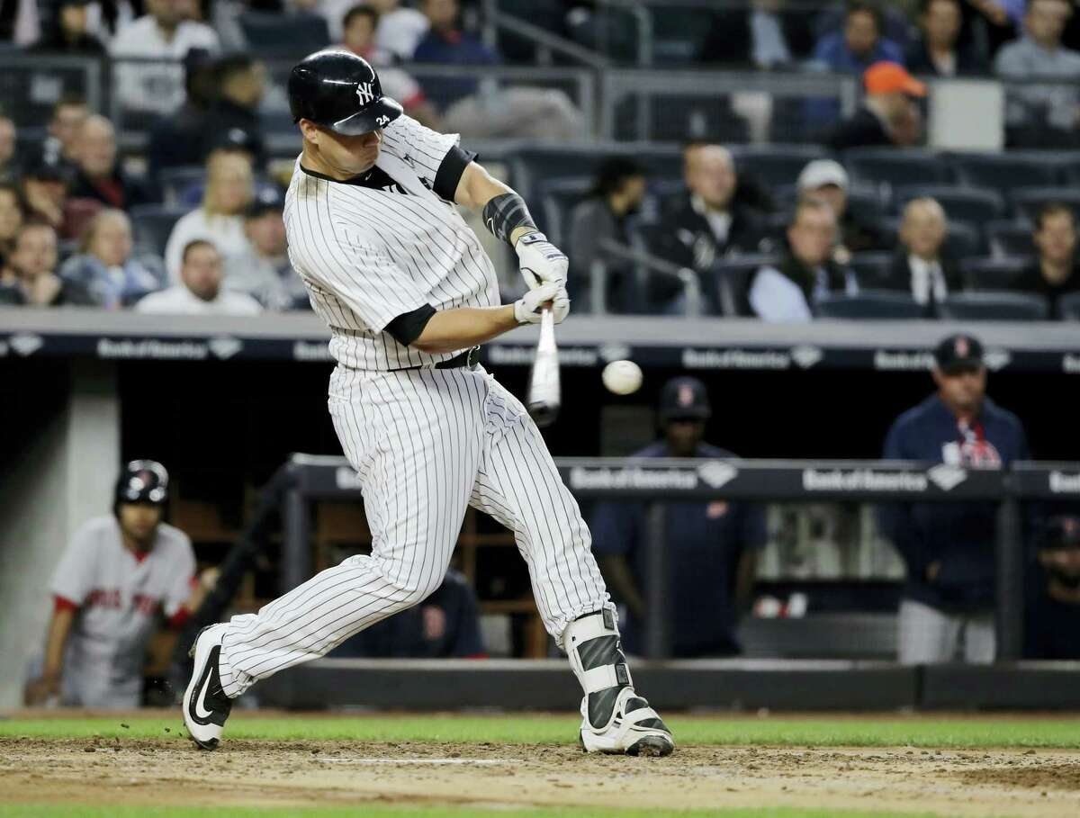 New York's Gary Sanchez hits a three-run home run during the third inning against the Boston Red Sox on Thursday. Sanchez homered twice in the Yankees' 9-1 win over the Red Sox.