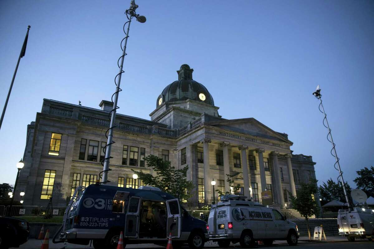 Television trucks are parked at the Montgomery County Courthouse for Bill Cosby's sexual assault trial at the in Norristown, Pa., Thursday, June 8, 2017. A jury that heard seven hours of testimony from a woman who says Cosby drugged and assaulted her may soon hear from Cosby himself 'Äî even if he doesn't take the stand. Prosecutors are expected to show jurors an earlier deposition in which Cosby said that he routinely gave women pills and alcohol before sexual encounters and gave at least one of them quaaludes, a now-banned sedative.