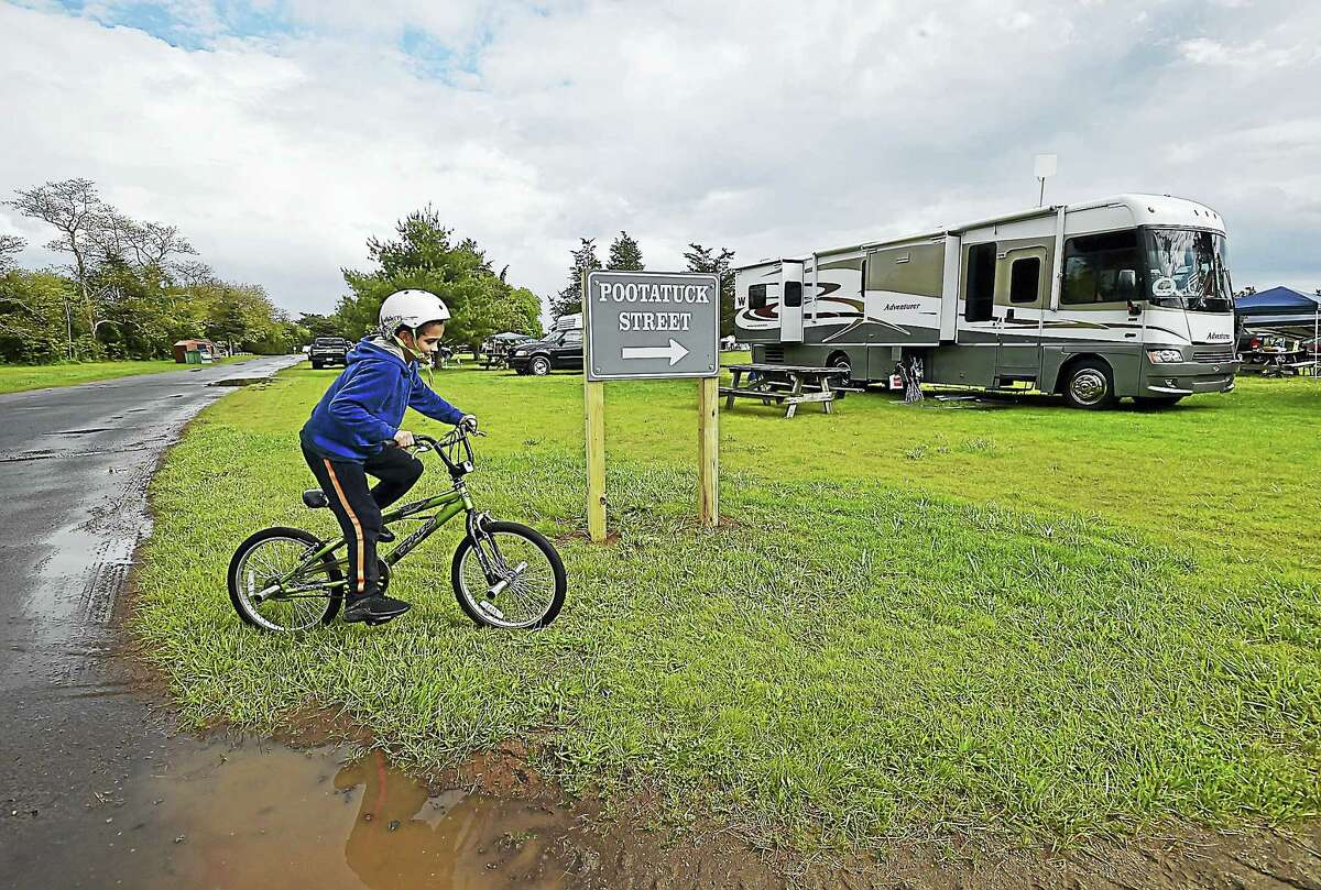 Mikey Maler, 10, of Branford rides around Pootatuck Street while his family sets up their RV for the Memorial Day weekend 2017, opening the 2017 camping season at Hammonasset Beach State Park in Madison. (Catherine Avalone — New Haven Register)