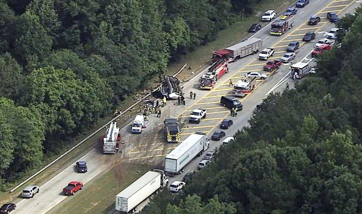 In this image made from video by WSB-TV Atlanta, authorities render assistance to injured people on an overturned church bus, Thursday, June 8, 2017, in Atlanta. Mount Zion Baptist Church in Huntsville, Ala., posted on its Facebook page that one of its buses with its student ministry mission was involved in a crash while traveling to the airport.