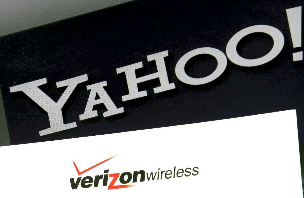 Yahoo and Verizon Wireless logos on a laptop, in North Andover, Mass.