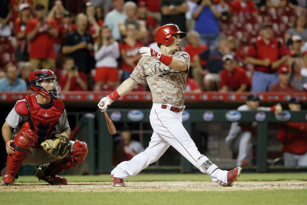 Cincinnati Reds' Scooter Gennett hits a two-run home run and his fourth overall in the eighth inning of a baseball game against the St. Louis Cardinals on June 6, 2017 in Cincinnati. The Reds won 13-1.