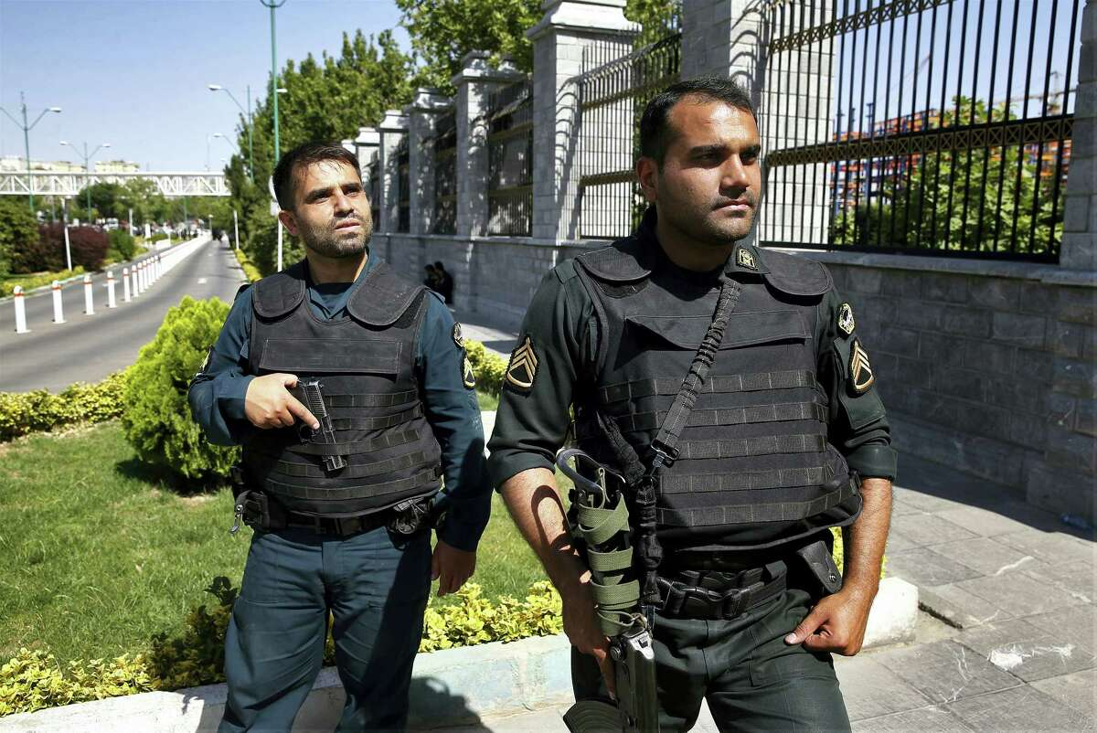 Police patrol outside Iran's parliament building after an assault by several attackers that was claimed by the Islamic State group, in Tehran, Iran, Wednesday, June 7, 2017. Gunmen and suicide bombers attacked Iran's parliament and the shrine of its revolutionary leader, killing at least 12 people, wounding dozens and igniting an hours-long siege at the legislature that ended with four attackers dead. It marked the first time the Sunni extremists have taken responsibility for an assault in Shiite-majority Iran.