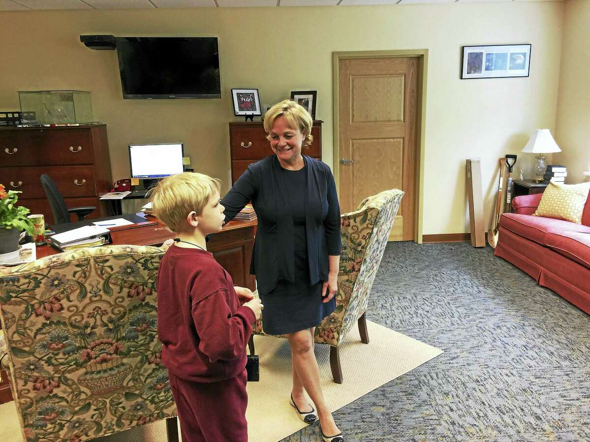 Lexy Cheek, a student at St. Peter/St. Francis, was named the Mayor for the Day in Torrington Wednesday. Above, Mayor Elinor Carbone chats with Lexy's younger brother Sam during the visit.