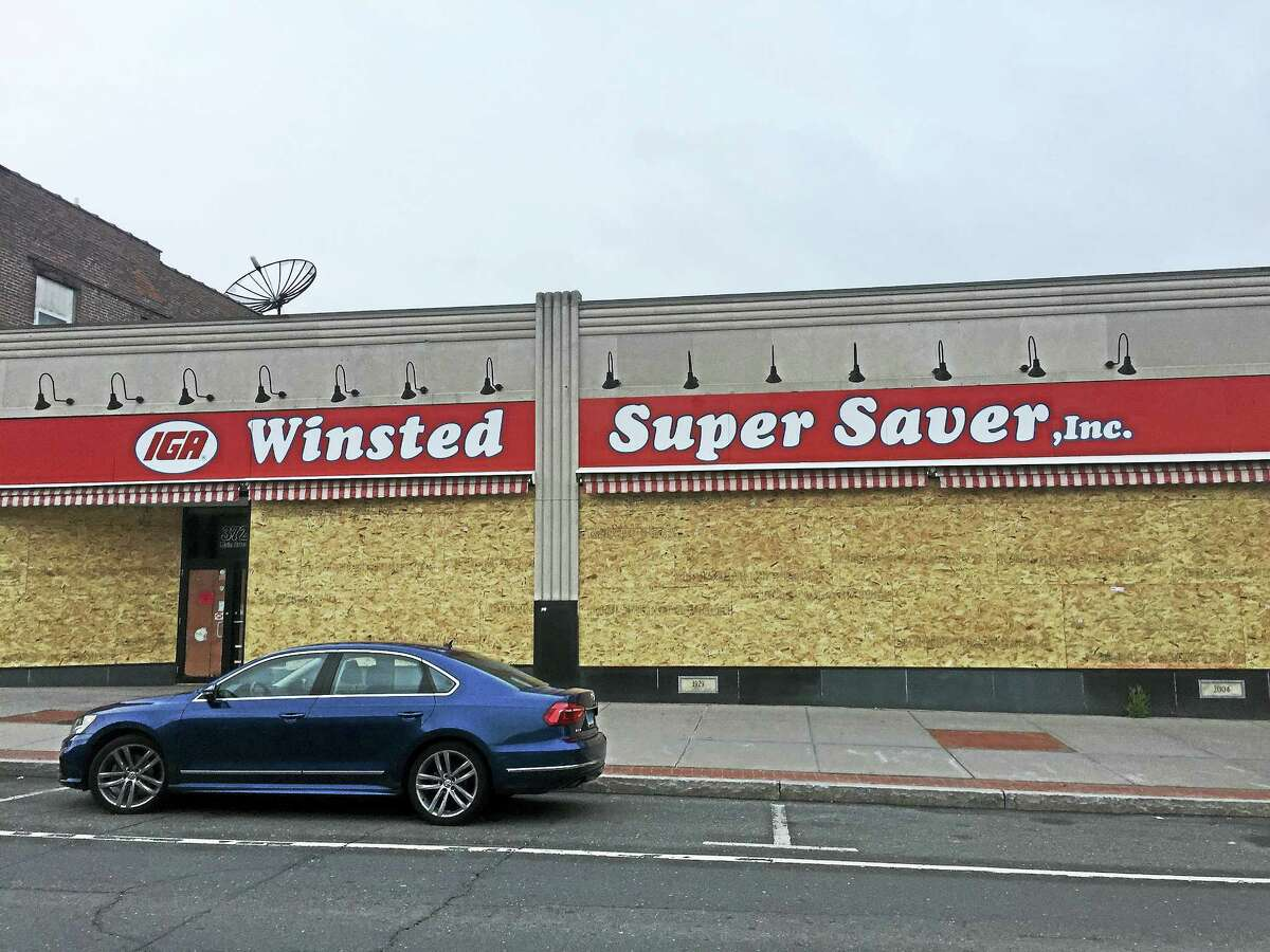 The now-closed Winsted Super Saver, as seen Tuesday. Its owner, John Dwan, who tried to sell the property to a community health center, has filed an ethics complaint against members of the Planning & Zoning Commission because, he says, they have violated their responsibilities as members.