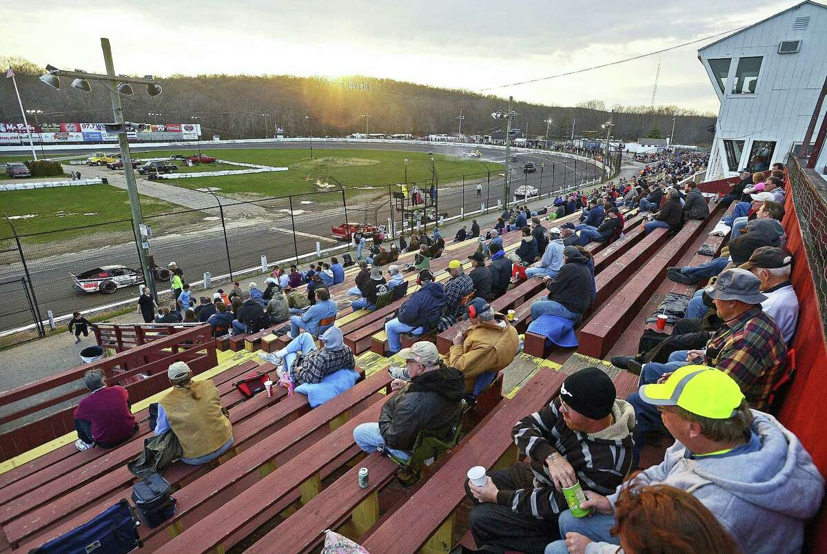 In this May 3, 2014 photo, fans watch a race at the New London Waterford Speedbowl in Waterford, Conn. The track, in operation since 1951, postponed its planned May 6, 2017 opening after NASCAR pulled its sanctions in April following the arrest of owner Bruce Bemer.