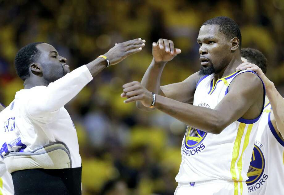 Warriors forward Kevin Durant, center, celebrates with Draymond Green, left, and Klay Thompson during Game 2 of the NBA Finals. Photo: Marcio Jose Sanchez — The Associated Press  / Copyright 2017 The Associated Press. All rights reserved.