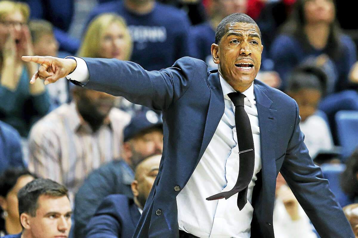 Connecticut head coach Kevin Ollie reacts during the first half of an NCAA college basketball game against Cincinnati in Storrs, Conn., Sunday, March 5, 2017. (AP Photo/Michael Dwyer)