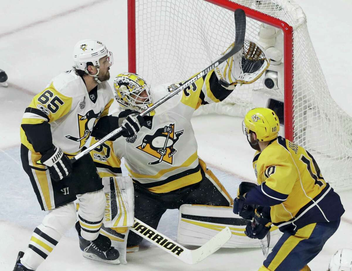 Penguins goalie Matt Murray and defenseman Ron Hainsey stop a shot by the Predators' Colton Sissons during Game 4 of the Stanley Cup Finals on Monday in Nashville.