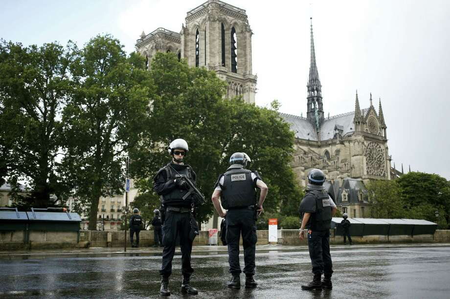 Police officers seal off the access to Notre Dame cathedral in Paris, France, Tuesday, June 6, 2017. Paris police say an unidentified assailant has attacked a police officer near the Notre Dame Cathedral, and the officer then shot and wounded the attacker. Photo: AP Photo/Matthieu Alexandre   / Copyright 2017 The Associated Press. All rights reserved.