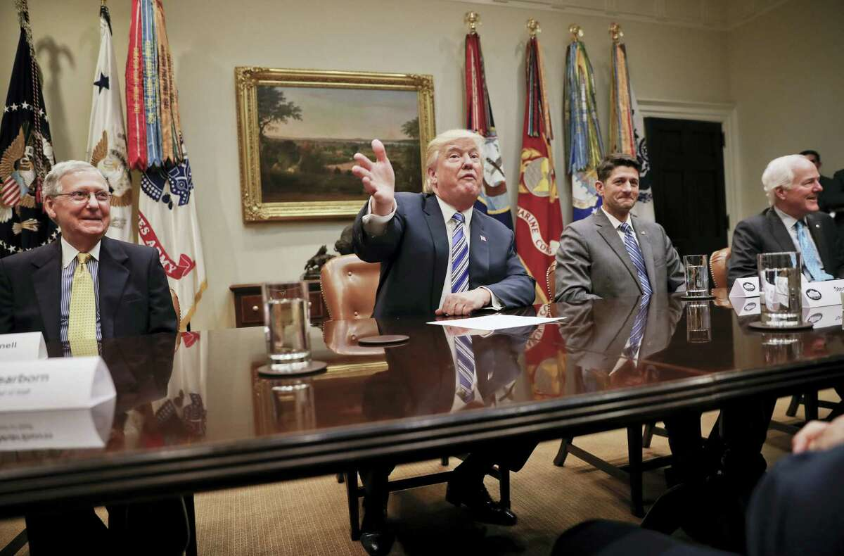 President Donald Trump, center, gestures during a meeting with House and Senate Leadership in the Roosevelt Room of the White House in Washington, Tuesday, June 6, 2017. With Trump are from left, Senate Majority Leader Mitch McConnell of Ky., House Speaker Paul Ryan of Wis., and Senate Majority Whip John Cornyn of Texas.