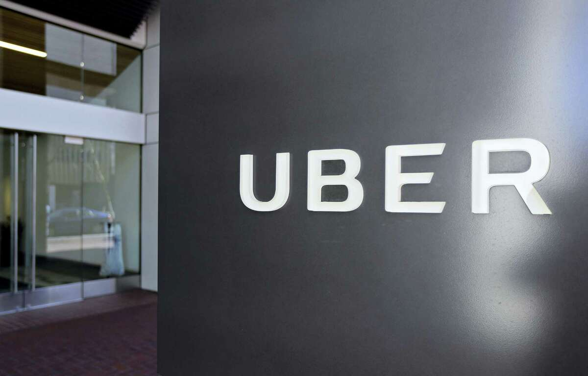 This March 1, 2017 file photo shows an exterior view of the headquarters of Uber in San Francisco. Uber has fired more than 20 employees after a law firm investigated complaints of sexual harassment, bullying, discrimination and other violations of company policies. An Uber spokeswoman says the firm Perkins Coie was hired after former engineer Susan Fowler posted a blog in February about sex harassment at the ride-hailing company. Fowler wrote that on her first day at work her boss propositioned her in a series of messages.