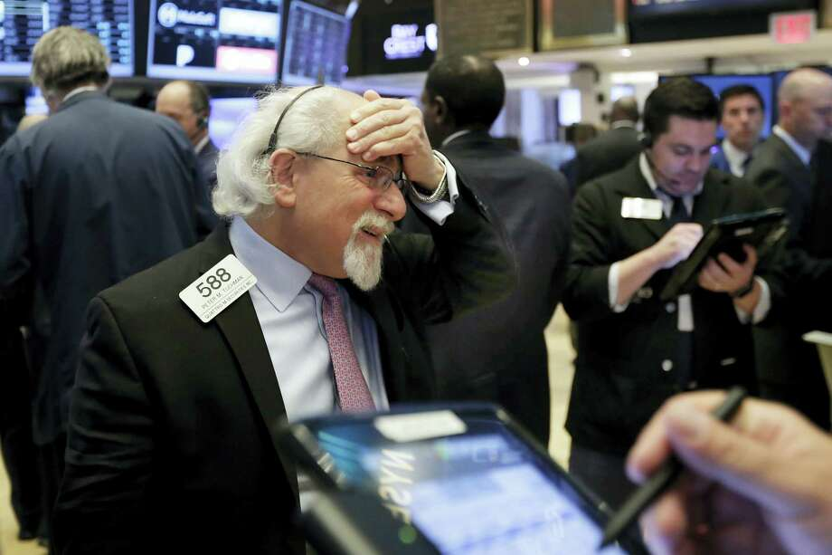 Trader Peter Tuchman works on the floor of the New York Stock Exchange Tuesday. Photo: Richard Drew — The Associated Press  / AP