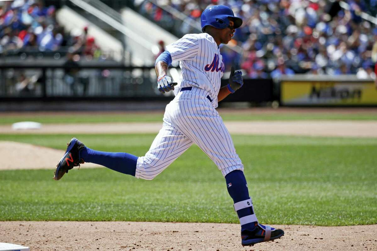In this May 21, 2017 photo, New York Mets' Curtis Granderson trots the bases after hitting a home run in an interleague baseball game against the Los Angeles Angels, in New York. This season, baseball has put footwear at the forefront, working with a new provider to create custom sock looks for almost all its teams, as well as special occasion designs for events like Mother'Äôs Day and the upcoming All-Star Game.