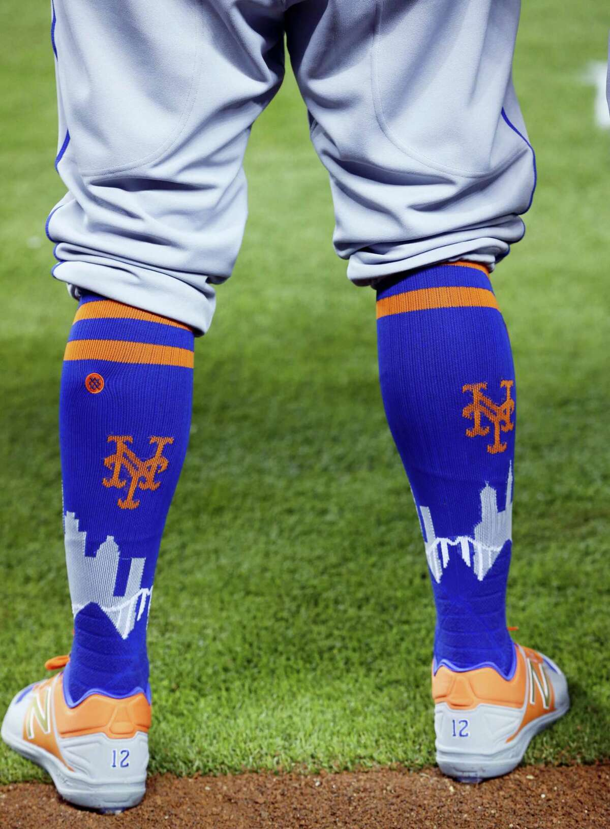 In this April 15, 2017 photo, New York Mets center fielder Juan Lagares' socks are shown before the start of a baseball game against the Miami Marlins in Miami. This season, baseball has put footwear at the forefront, working with a new provider to create custom sock looks for almost all its teams, as well as special occasion designs for events like Mother's Day and the upcoming All-Star Game.