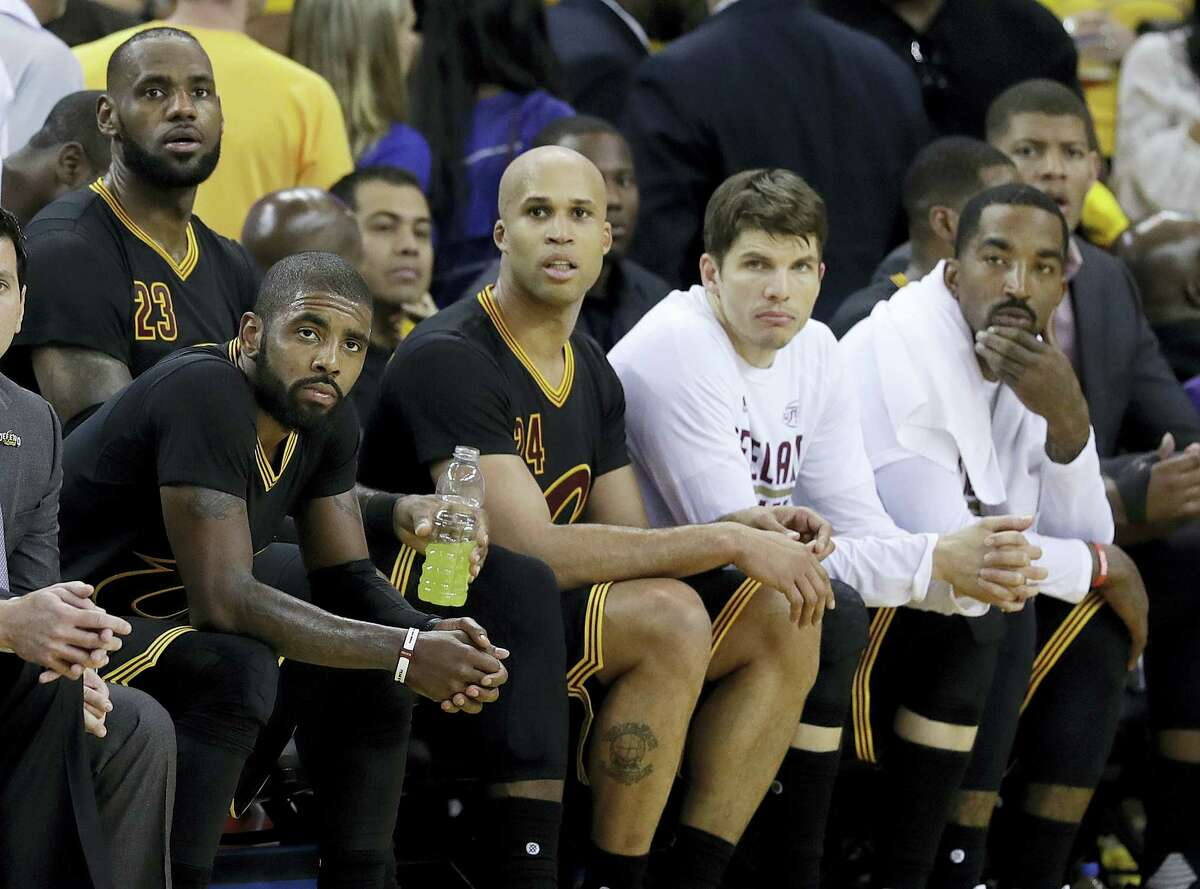 Cleveland Cavaliers' Kyrie Irving, seated from left, LeBron James, Richard Jefferson, Kyle Korver and J.R. Smith sit on the bench during the second half of Game 2 of basketball's NBA Finals against the Golden State Warriors in Oakland, Calif. on June 4, 2017.