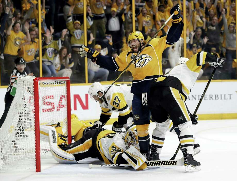 Predators right wing Craig Smith, center, celebrates a goal by teammate Calle Jarnkrok during the first period in Game 4 on Monday. Photo: Mark Humphrey — The Associated Press  / Copyright 2017 The Associated Press. All rights reserved.