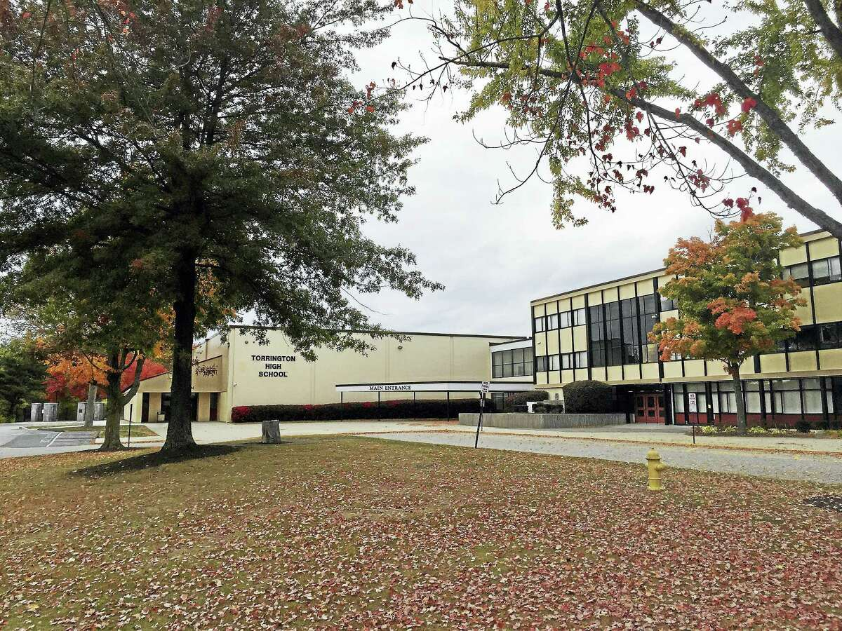 A teen was arrested Monday for allegedly writing threatening messages on walls of bathrooms in Torrington High School.