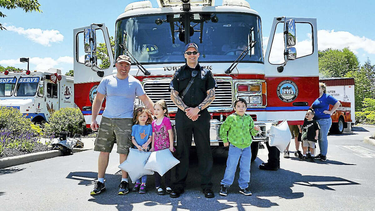 Justin Maksymiuk, a firefighter with the Torrington Fire Department showed families Fire Engine No. 2.