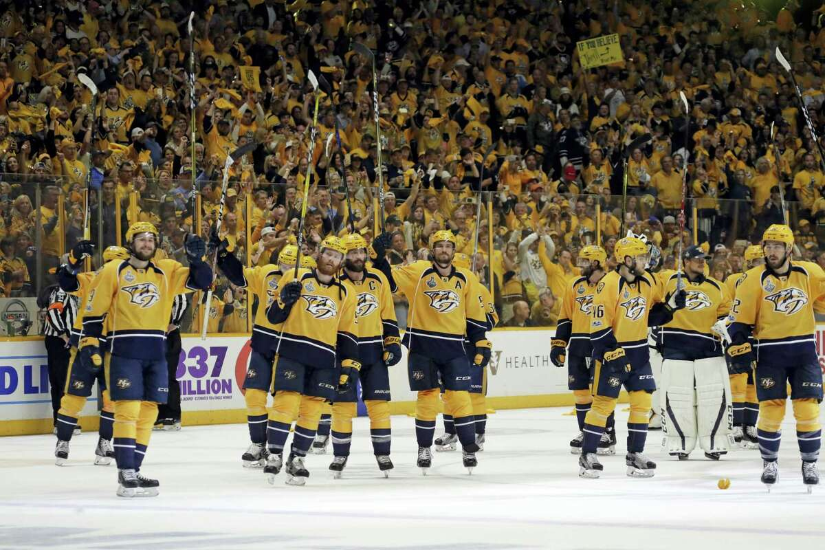 Nashville Predators players salute fans after Game 3 of the NHL hockey Stanley Cup Finals against the Pittsburgh Penguins Saturday, June 3, 2017, in Nashville, Tenn. The Predators won 5-1. (AP Photo/Mark Humphrey)