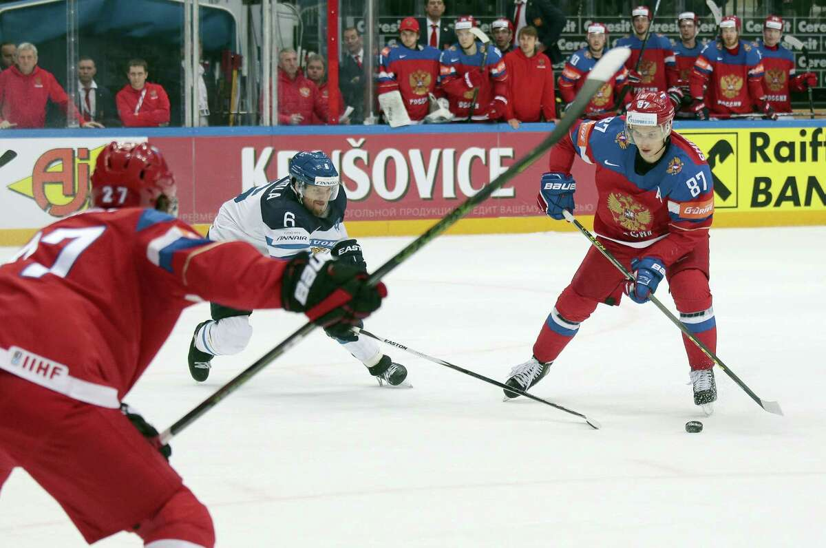 In this May 21, 2016 photo, Russia's Vadim Shipachyov, right, challenges for the puck with Finland's Topi Jaakola, left, during an Ice Hockey World Championships semifinal match in Moscow, Russia. As the Kontinental Hockey League improves its coaching and development, established players like Shipachyov are expected to make immediate impact.