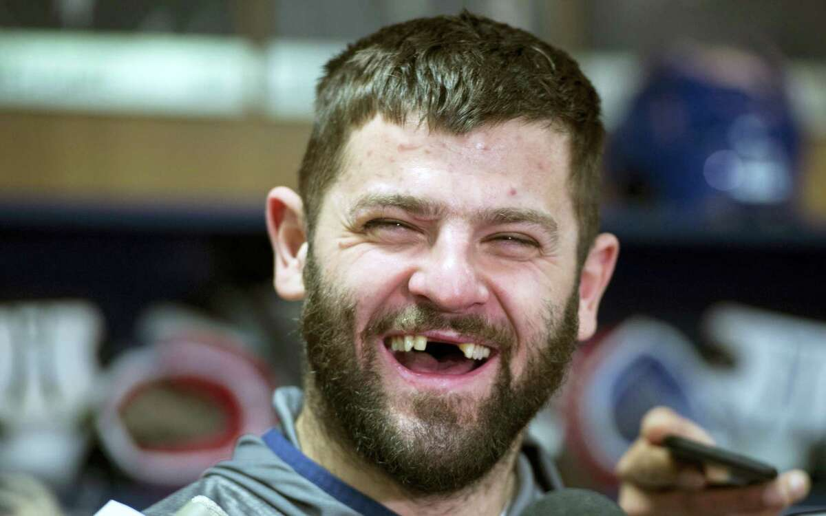 In this April 24, 2017photo, Montreal Canadiens' Alexander Radulov, of Russia, laughs as he talks with reporters in Brossard, Quebec. A combination of factors has made the NHL assimilation for Russian players quicker than ever.