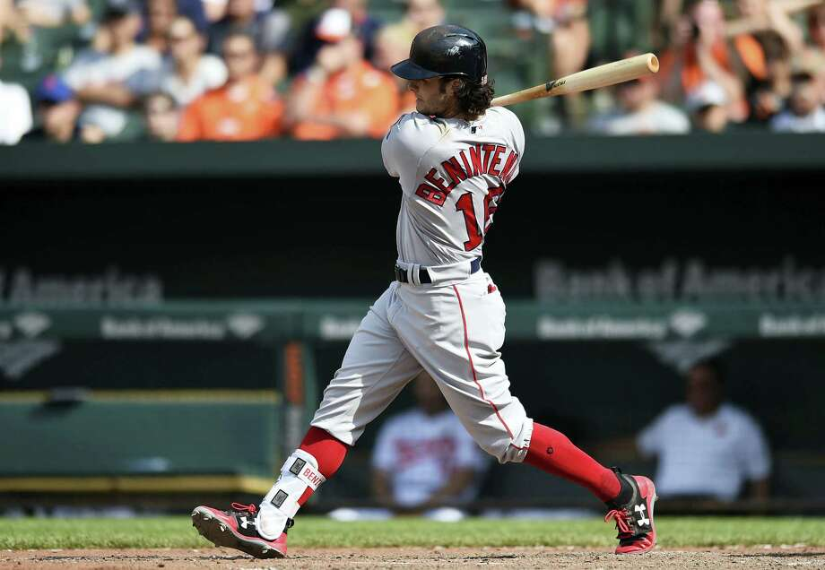 Boston's Andrew Benintendi follows through on a single against the Baltimore Orioles in the ninth inning Sunday in Baltimore. Photo: Gail Burton — The Associated Press  / FR4095 AP